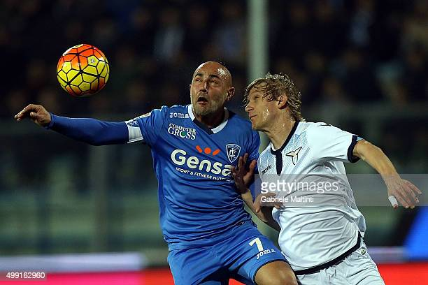 Massimo Maccarone of Empoli FC battles for the ball with Dusan Basta of SS Lazio during the Serie A match between Empoli FC and SS Lazio at Stadio...