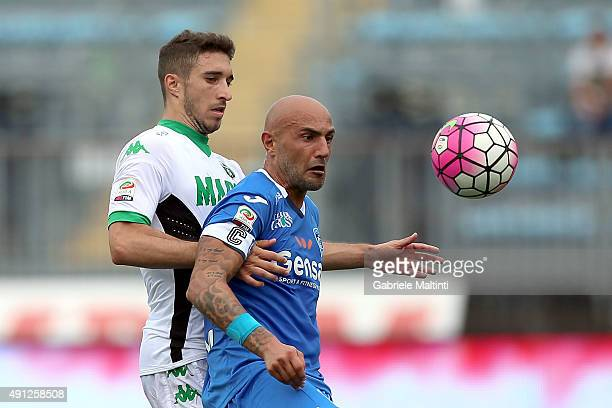 Massimo Maccarone of Empoli FC battles for the ball with Federico Peluso of US Sassuolo Calcio during the Serie A match between Empoli FC and US...