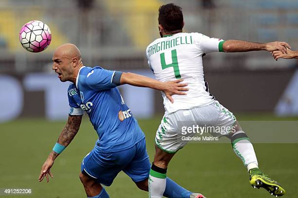 Massimo Maccarone of Empoli FC battles for the ball with Francesco Magnanelli of US Sassuolo Calcio during the Serie A match between Empoli FC and US...