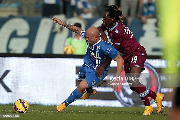 Massimo Maccarone of Empoli FC battles for the ball with Luis Pedro Candreva of SS Lazio during the Serie A match between Empoli FC and SS Lazio at...