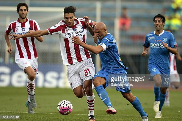 Massimo Maccarone of Empoli FC battles for the ball with Mario Sampirisi of Vicenza Calcio during the TIM Cup match between Empoli FC and Vicenza...