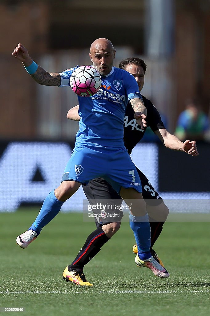 Massimo Maccarone of Empoli FC battles for the ball with Matteo Brighi of Bologna Fc during the Serie A match between Empoli FC and Bologna FC at Stadio Carlo Castellani on May 1, 2016 in Empoli, Italy.
