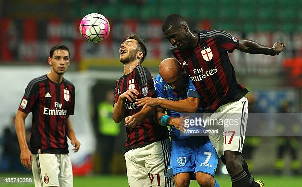 Massimo Maccarone of Empoli FC competes for the ball with Andrea Bertolacci and Cristian Zapata of AC Milan during the Serie A match between AC Milan...