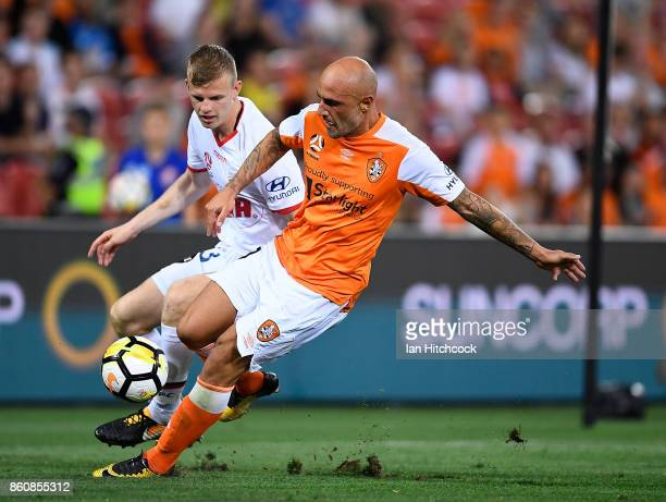Massimo Maccarone of the Roar wins the ball from Jordan Elsey of Adelaide United during the round two ALeague match between the Brisbane Roar and...