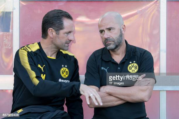 Massimo Mariotti of Dortmund speak with Head coach Peter Bosz of Dortmund during a friendly match between Espanyol Barcelona and Borussia Dortmund as...