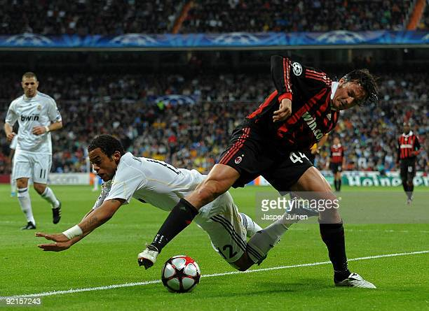 Massimo Oddo of AC Milan duels for the ball with Marcelo Vieira of Real Madrid during the Champions League group C match between Real Madrid and AC...