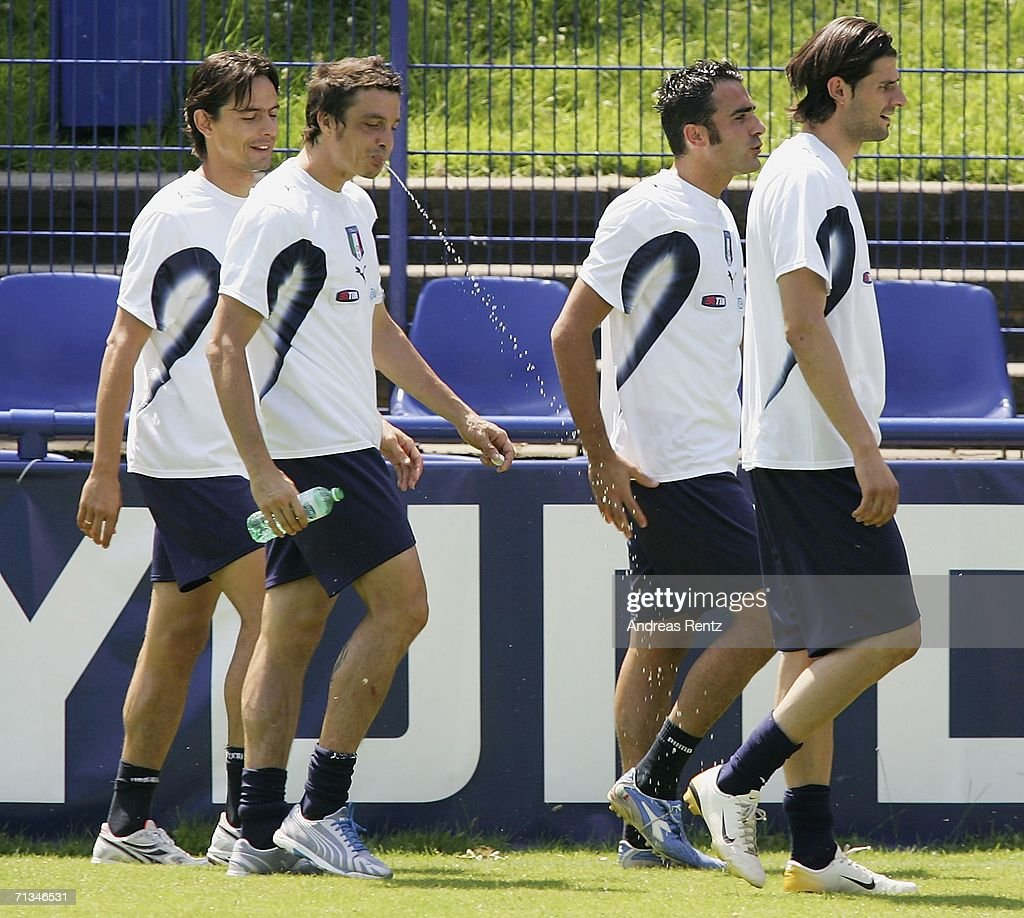 Massimo Oddo (2nd from L) spits out water as Filippo Inzaghi (L) looks on during an Italy National Football Team training session on July 01, 2006 in Duisburg, Germany.