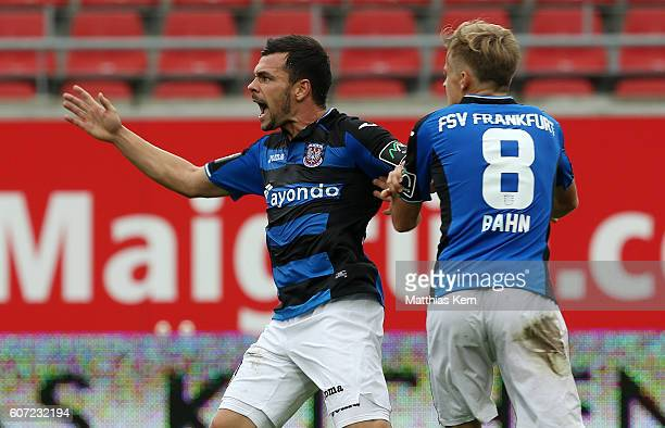 Massimo Ornatelli of Frankfurt jubilates with team mate Bentley Baxter Bahn after scoring the first goal during the third league match between...