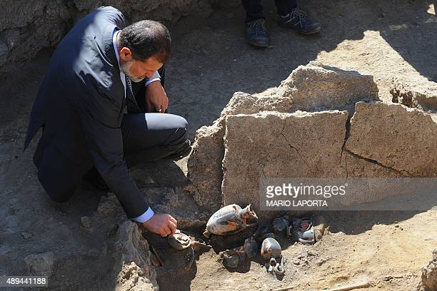 Massimo Osanna superintendent of Pompeii ruins shows a Samnite tomb of the fourth century BC with a woman's skeleton and many amphoras discovered...