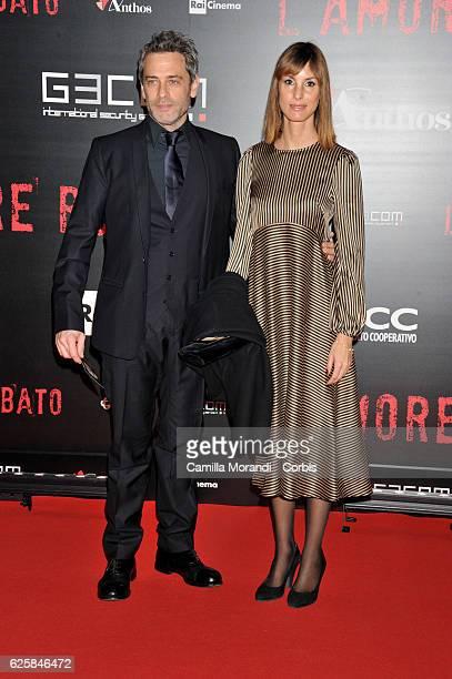 Massimo Poggio and Claudia Poggio walk a red carpet for 'L'Amore Rubato' on November 25 2016 in Rome Italy