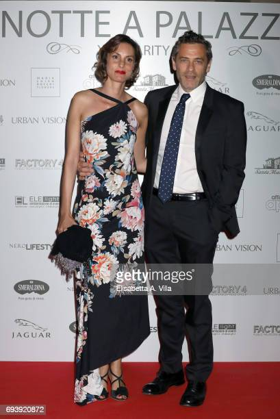 Massimo Poggio and fiancee Claudia attend Anlaids Gala at Palazzo Doria Pamphilj on June 8 2017 in Rome Italy