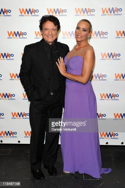 ACCESS *** Massimo Raniele and Barbara De Rossi attend the Wind Music Awards Backstage at the Arena of Verona on May 29 2010 in Verona Italy