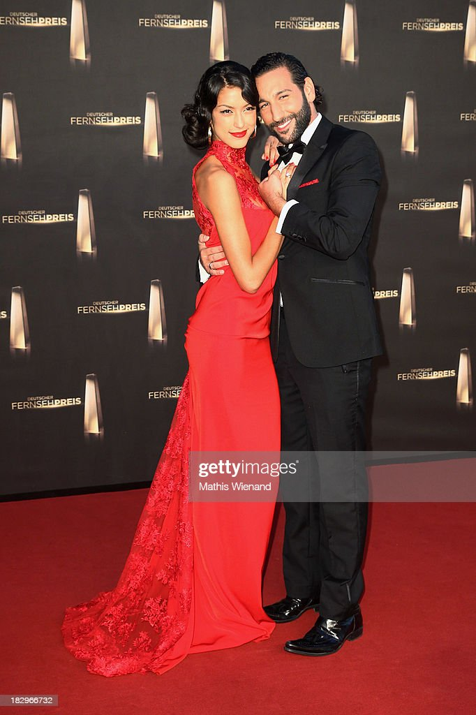 Massimo Sinato and Rebecca Mir arrive at the red carpet of the 'Deutscher Fernsehpreis 2013' at Coloneum on October 2, 2013 in Cologne, Germany.