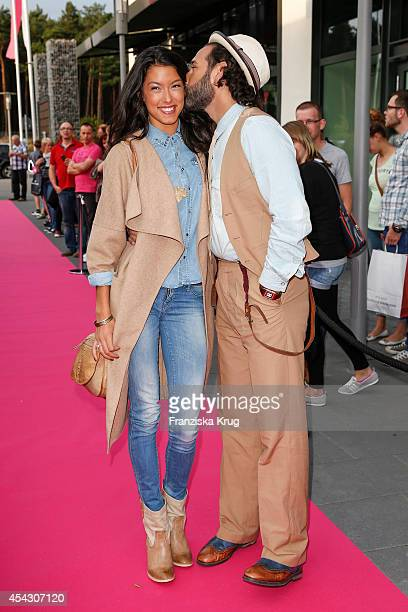 Massimo Sinato and Rebecca Mir attend the Late Night Shopping Designer Outlet Soltau on August 28 2014 in Soltau Germany