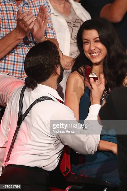 Massimo Sinato presents a marriage proposal to Rebecca Mir during the final show of the television competition 'Let's Dance' on June 5 2015 in...