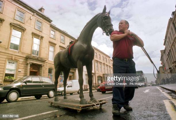 A massive 15 hands high wooden horse stopped traffic in Glasgow when porter David Burnett loaded the model into his lorry for it`s long journey south...