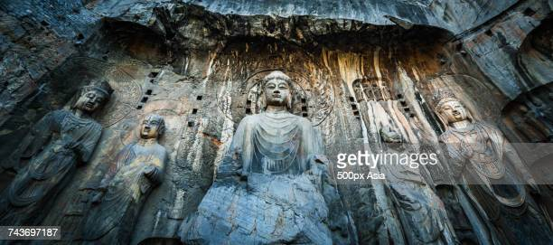 Massive Buddhist sculptures in the main grotto of Longmen Caves in Luoyang, Henan, China