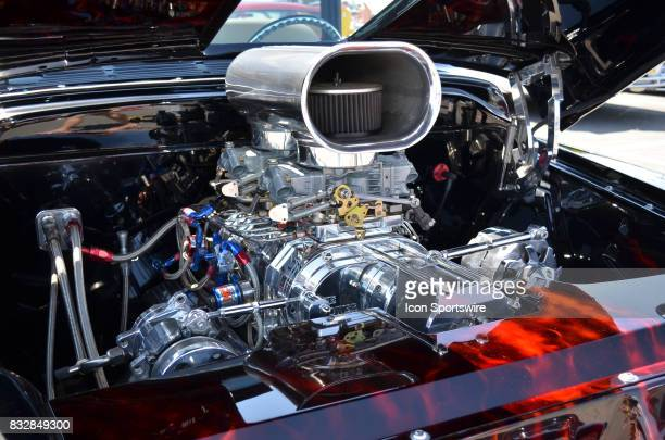 Massive chromed V8 engine is housed in a 1957 Chevy 3100 at the Hot August Nights Custom Car Show the largest nostalgic car show in the world on...