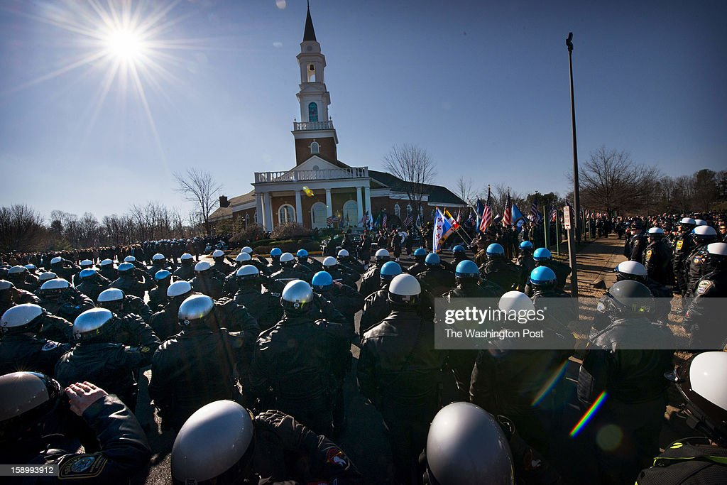 A massive crowd including police units from many jurisdictions attend the funeral services for Prince William County Police Officer Chris Yung at Hylton Memorial Chapel in Woodbridge, VA on Friday, January 4, 2013.