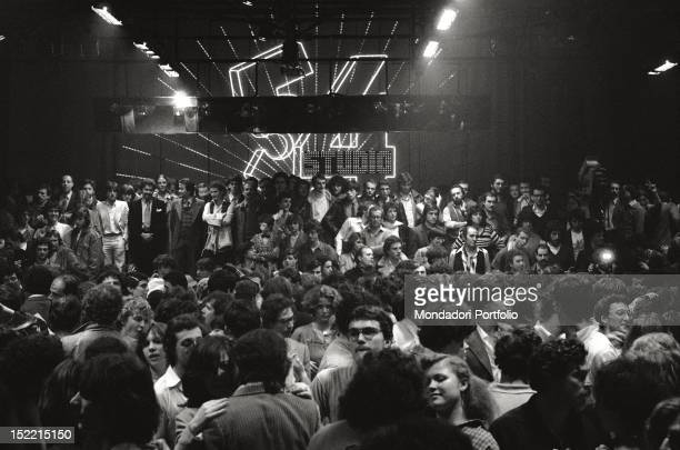 A massive crowd on the dance floor of Studio 54 disco Milan 1979