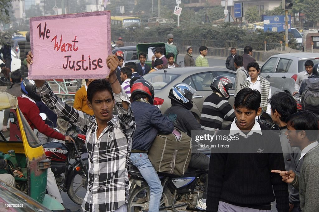 Massive protest by students in support of rape victim at Sector 49 on December 27, 2012 in Noida, India. Huge traffic jam was witnessed and agitated mob ransacked some vehicles after which police had to Lathi charge to bring situation back to normal.