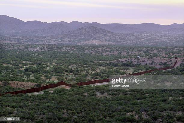 A massive steel fence built by the United States to deter illegal immigration separates the United States and Mexico June 1 2010 near Sasabe Arizona...