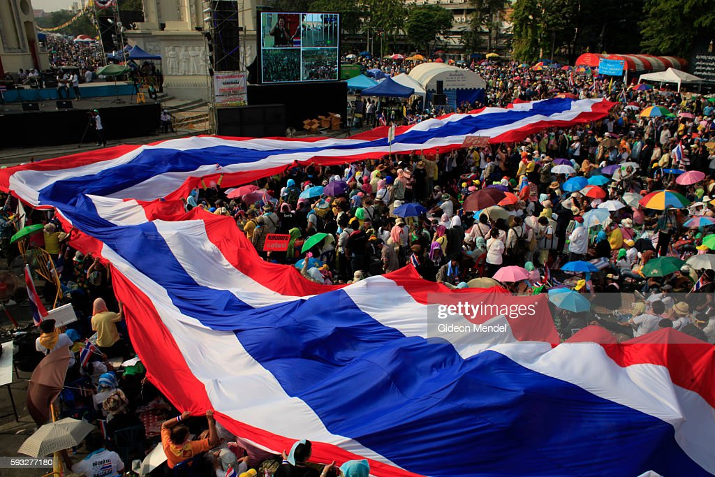 A massive Thai flag being passed over the crowd near to the Democracy Monument Thai Prime Minister Yingluck Shinawatra dissolved parliament on Monday...