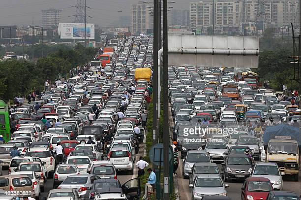 A massive traffic Jam on NH24 due to Kanwarias movement on August 10 2015 in New Delhi India Every year millions of Shiv Bhakts take on pilgrimage to...