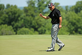 Massy Kuramoto of Japan celebrates a birdie on the 16th hole during the second round of the Senior PGA Championship Presented By KitchenAid at the...