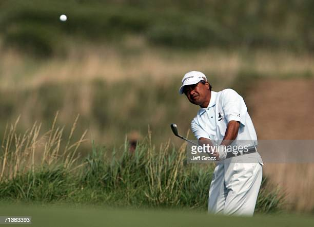 Massy Kuramoto of Japan hits a pitch shot to the ninth green during the first round of the US Senior Open at the Prairie Dunes Country Club on July 6...