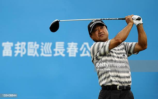 Massy Kuramoto of Japan tees off on the 1st hole during day two of the Fubon Senior Open at Miramar Golf Country Club on November 19 2011 in Taipei...