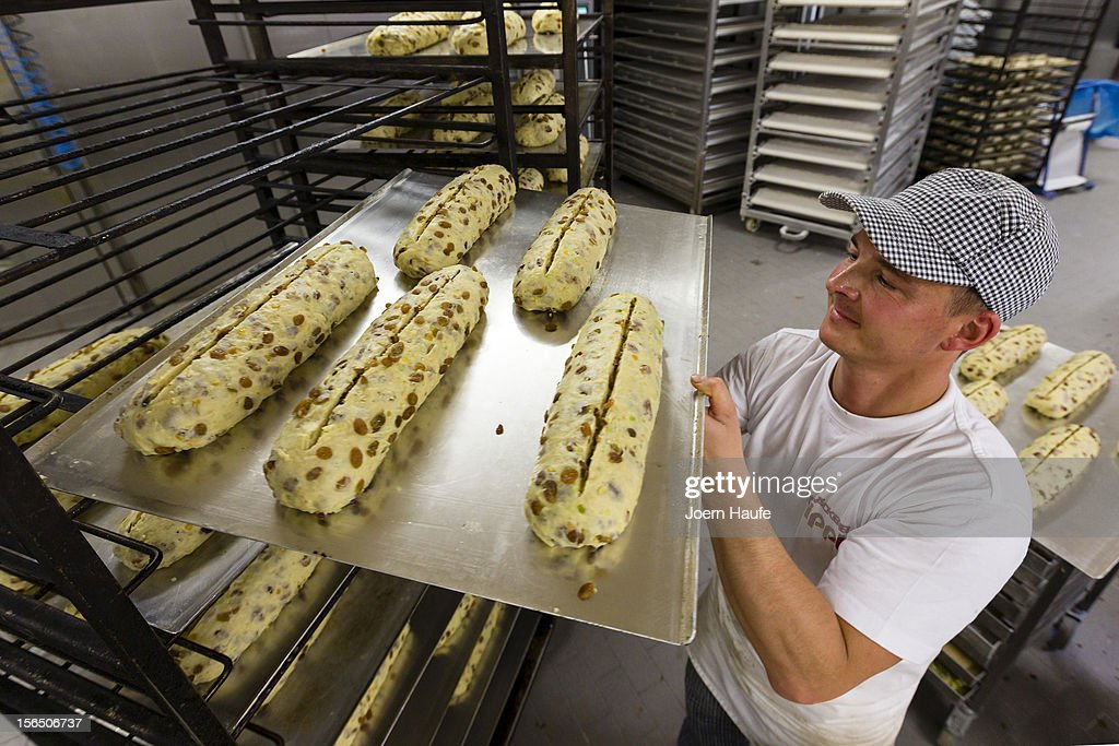 Master Baker Andreas Wippler prepares Original Dresden Christmas Stollen at the Wippler bakery on November 16, 2012 in Dresden, Germany. Stollen loaves come in several forms, including with raisins or almonds, and are among the traditional German Christmas foods. Dresden is home to a long Stollen tradition and bakeries must qualify for a 'Golden Seal' in order to call their Stollen 'Dresden Stollen'.
