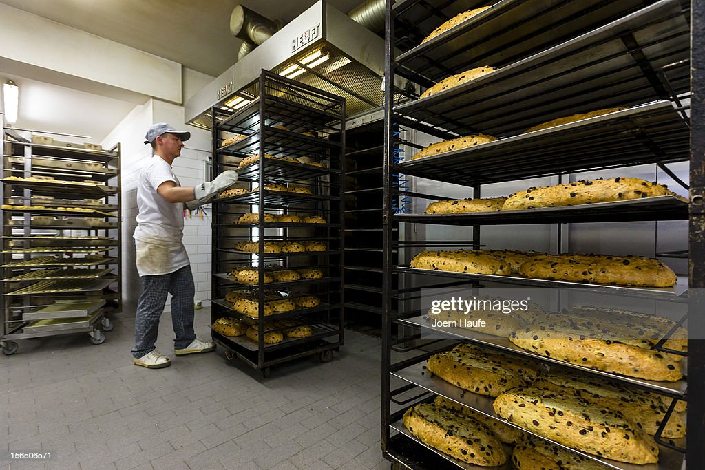 Master Baker Andreas Wippler pulls trays of Stollen Christmas loaves from a oven, at the Wippler bakery on November 16, 2012 in Dresden, Germany. Stollen loaves come in several forms, including with raisins or almonds, and are among the traditional German Christmas foods. Dresden is home to a long Stollen tradition and bakeries must qualify for a 'Golden Seal' in order to call their Stollen 'Dresden Stollen'.