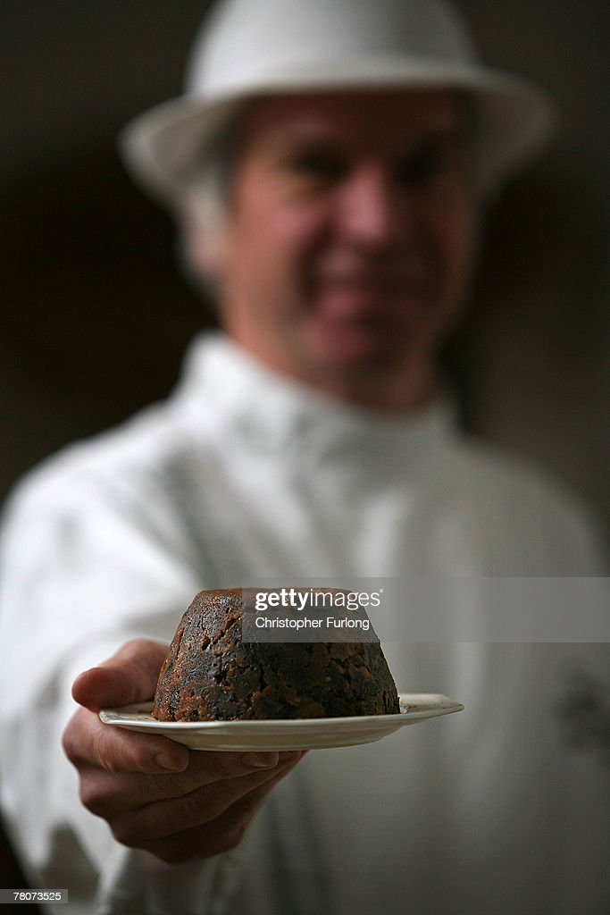 Master baker John Pimblett shows off one his award winning Christmas puddings at his bakery on November 12, 2007 in St Helens, England. John Pimblett's bakery has been busy making it's speciality Christmas puddings in time for the seasonal rush. John is the third generation baker since 1921 who have been making cakes and pies in the merseyside bakery. Pimblett's award winning Christmas puddings are made in the traditional way but with a few secret ingredients says John. Pimblett's Christmas puddings can be found in all the best delicatessens around Britain and abroad.