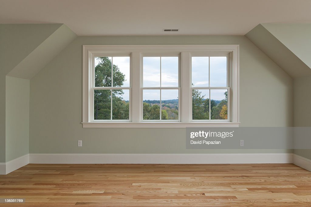 Master bedroom with view and hardwood floors. : Stock Photo