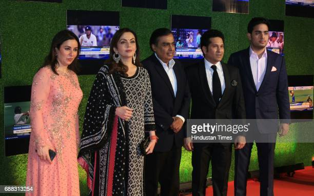 Master blaster Sachin Anjali Tendulkar along with Nita Ambani Mukesh Ambani and Akash Ambani during the premier of his biopic 'Sachin A Billion...