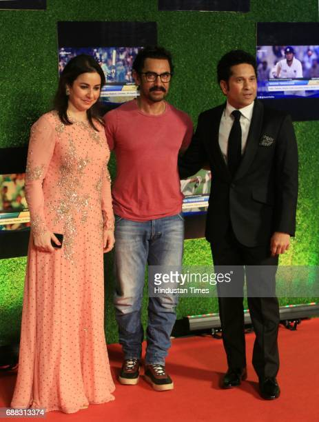 Master blaster Sachin Tendulkar and wife Anjali Tendulkar along with actor Aamir khan during the premiere of his biopic 'Sachin A Billion Dreams' on...