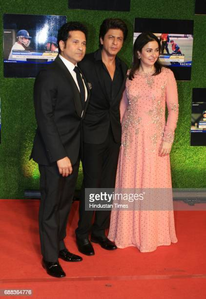 Master blaster Sachin Tendulkar and wife Anjali Tendulkar along with actor Shah Rukh Khan during the premiere of his biopic 'Sachin A Billion Dreams'...