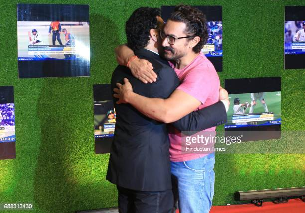 Master blaster Sachin Tendulkar greets actor Aamir khan during the premiere of his biopic 'Sachin A Billion Dreams' on May 24 2017 in Mumbai India...
