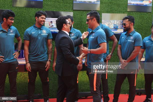 Master Blaster Sachin Tendulkar greets Mahendra Singh Dhoni during the screening of 'Sachin A Billion Dreams' film at PVR on May 24 2017 in Mumbai...