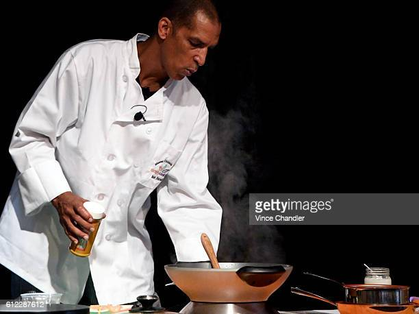 DENVER CO Master Cannabis Chef Scott Durrah prepares a marijuanainfused Jamaican curry chicken dish at a Cooking with Cannabis seminar presented by...