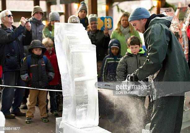 Master carver Richard Daly carves a whale out of a block of ice during the Wildlife Conservation Society's Bronx Zoo 'Salute to Wildlife Ice Carving...