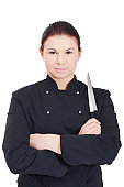 Master chef with a knife in a black jacket