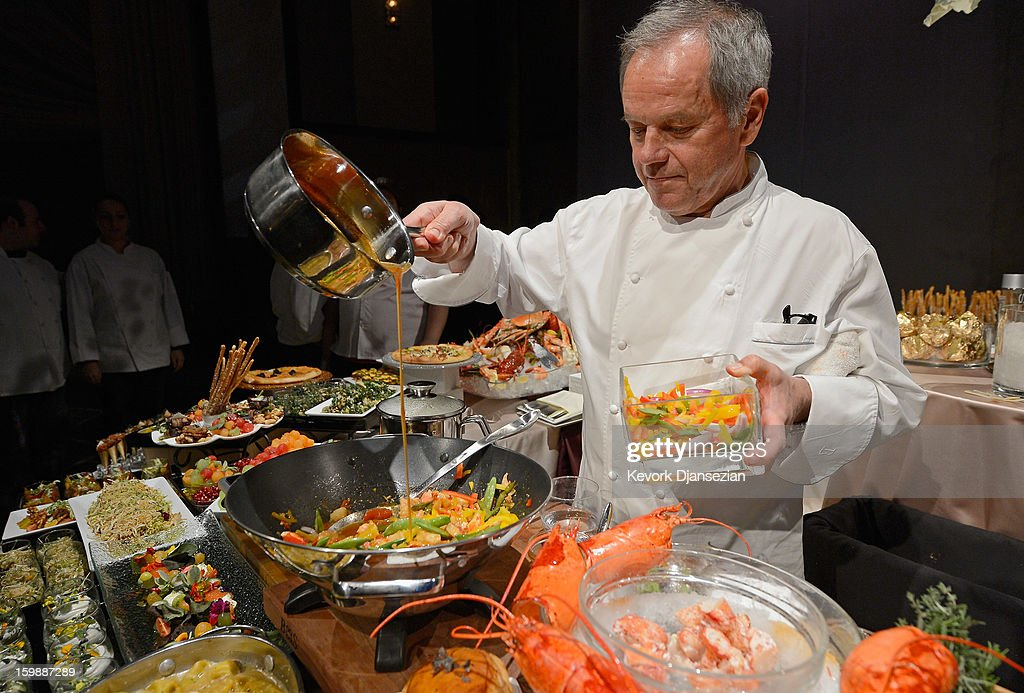 Master chef Wolfgang Puck cooks a lobster with black bean sauce during a preview of the Governors Ball on January 22, 2013 in Hollywood, California. Academy governor Jeffrey Kurland, event producer Cheryl Cecchetto and Puck will return to create this year's Governors Ball, the Academy's official post-Oscar celebration, which will immediately follow the 85th Academy Awards ceremony on Sunday, February 24. The 1,500 guests include Academy Award winners and nominees, show presenters and other telecast participants.