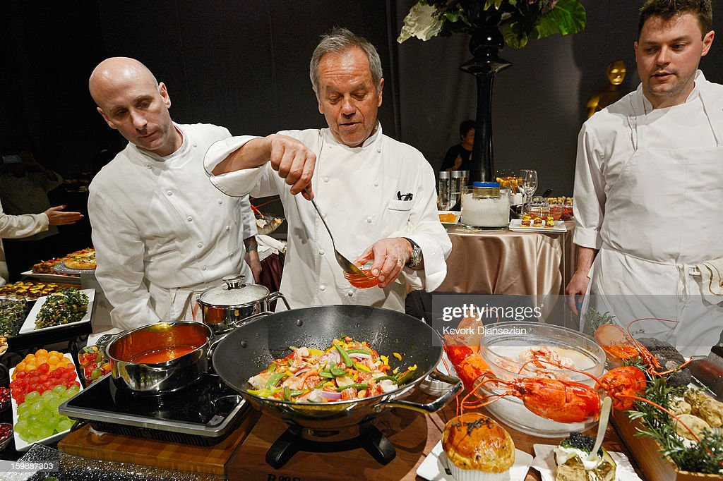 Master Chef Wolfgang Puck (C) cooks a lobster with black bean sauce as sous chefs Matthew Bencienvega (L) and Michael Pennick look on during a preview of the Governors Ball on January 22, 2013 in Hollywood, California. Academy governor Jeffrey Kurland, event producer Cheryl Cecchetto and Puck will return to create this year's Governors Ball, the Academy's official post-Oscar celebration, which will immediately follow the 85th Academy Awards ceremony on Sunday, February 24. The 1,500 guests include Academy Award winners and nominees, show presenters and other telecast participants.