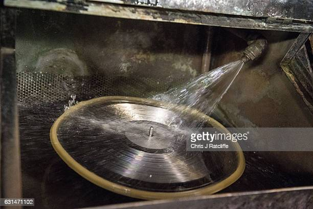 A master copy of a vinyl record is cleaned before being submerged into nickel plating solution before being ready to press records at The Vinyl...