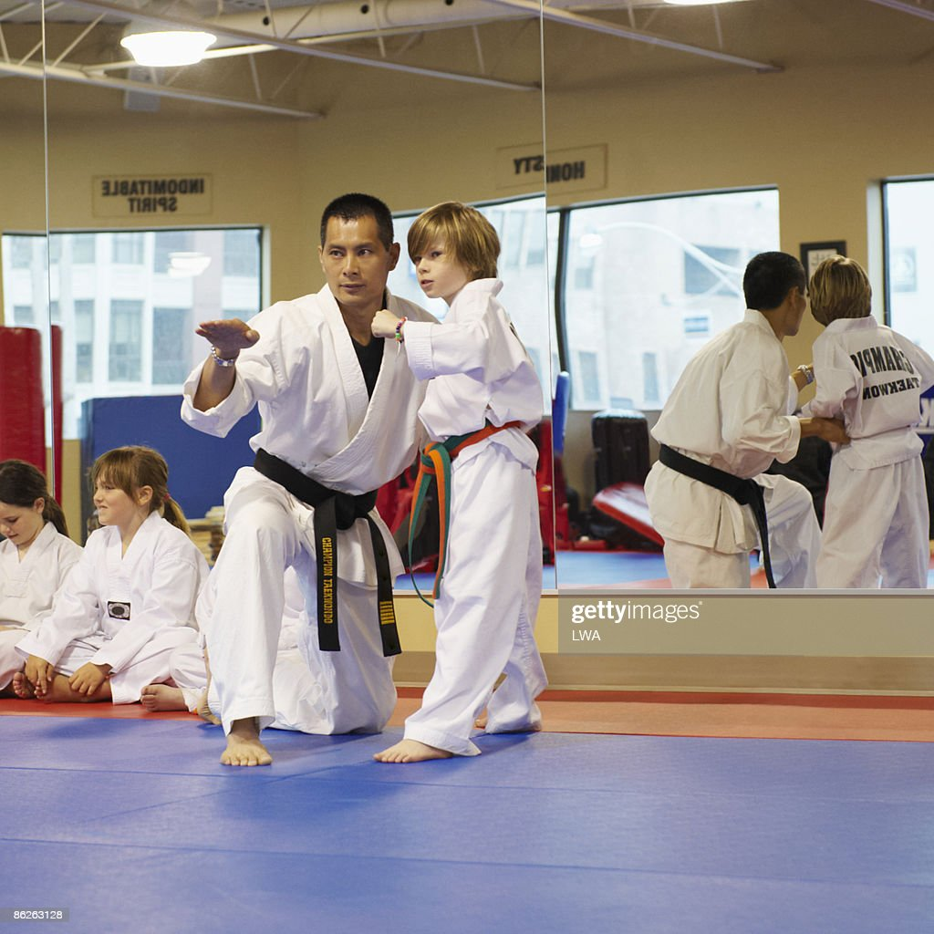 Master Instructing Student In Tae Kwon Do Class
