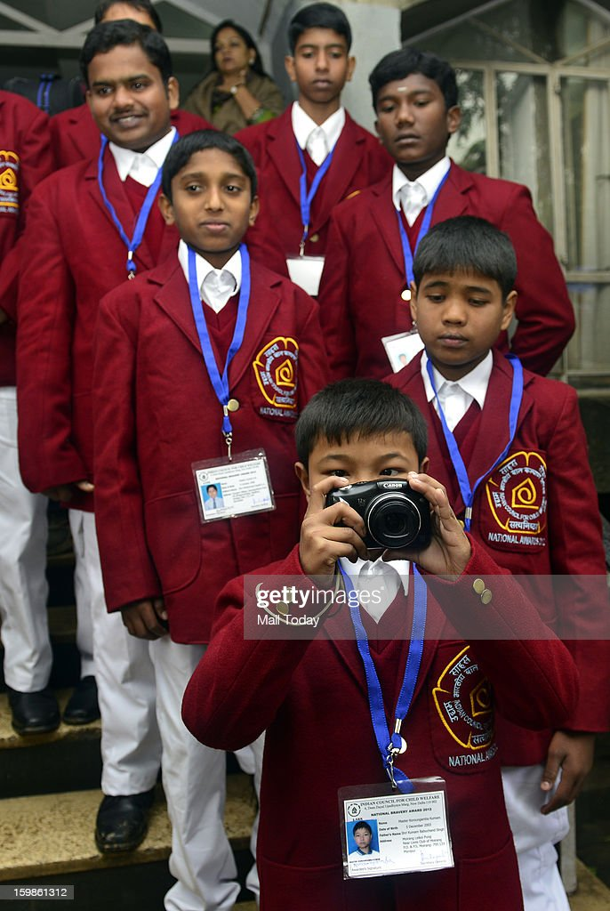 Master Koroungamba Kumam of Manipur takes picture of press photographers as other brave children look on during a press conference for the National Bravery Awards 2012, in New Delhi on Friday.