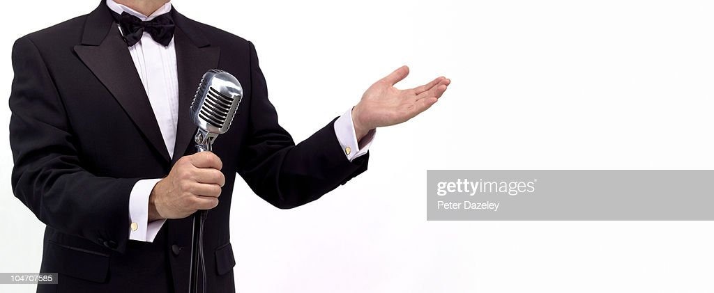 Master of ceremonies comedian with microphone : Stock Photo