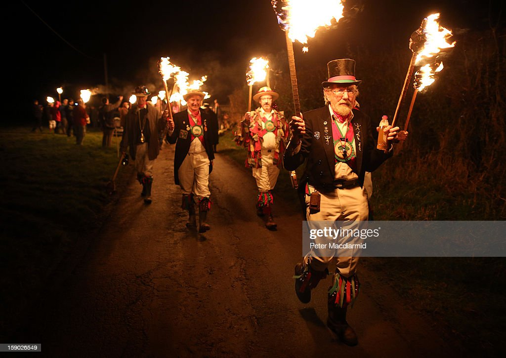 Master of ceremonies Doug Parrott leads a torchlit procession to the orchard during the Apple Howling ceremony at Old Mill Farm on January 5, 2013 in Bolney, England. In this ancient ritual villagers surround the oldest and largest tree in the orchard and evil spirits are driven out and good spirits are encouraged to produce a bountiful apple crop for the following year's cider drink.